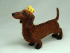 Queenie, needle felted dachshund wearing a crown